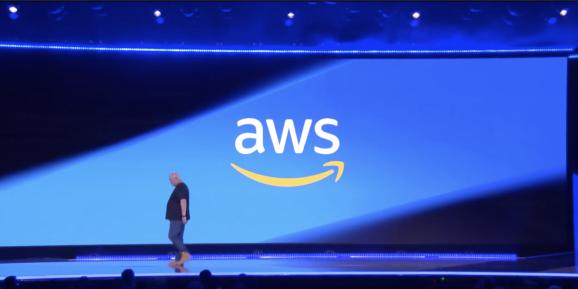 AWS CTO Werner Vogels profiled against giant blue presentation screen
